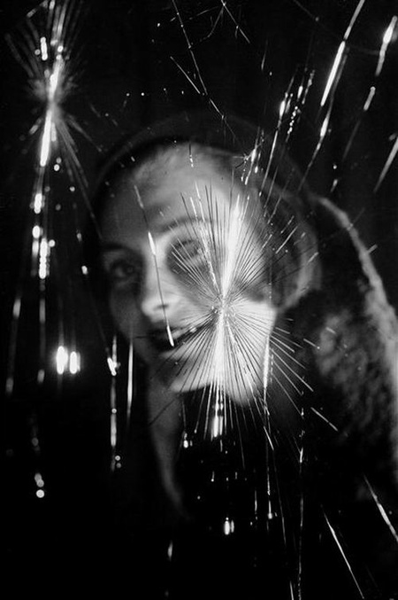 Fosco Maraini, Face seen through a broken window, c.1950