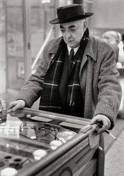 Brassaï playing pinball by Willy Ronis, 1954
