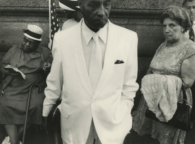 Untitled (man in white suit, women on either side), date unknown